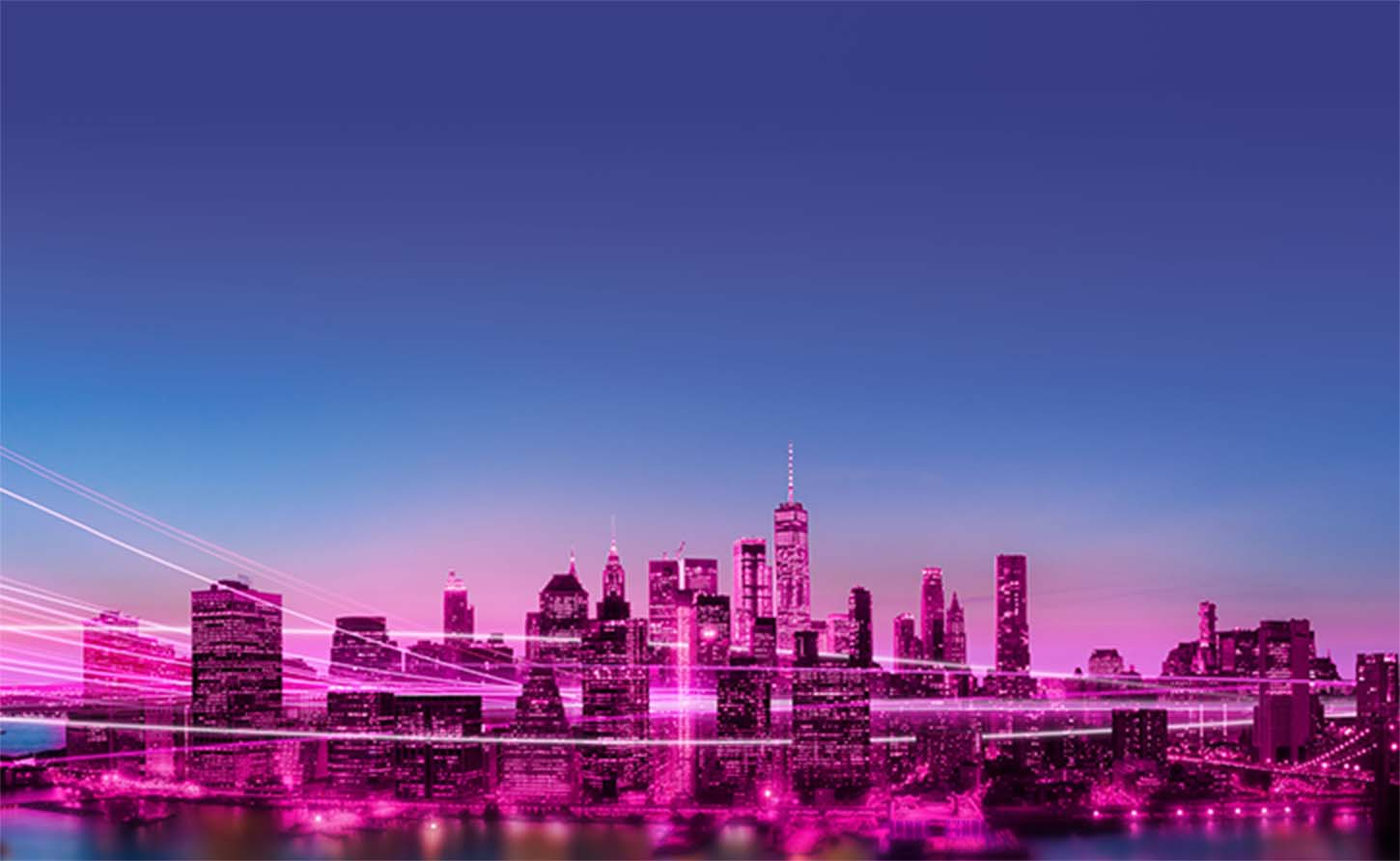Skyline colored pink with streaks of light flowing through buildings